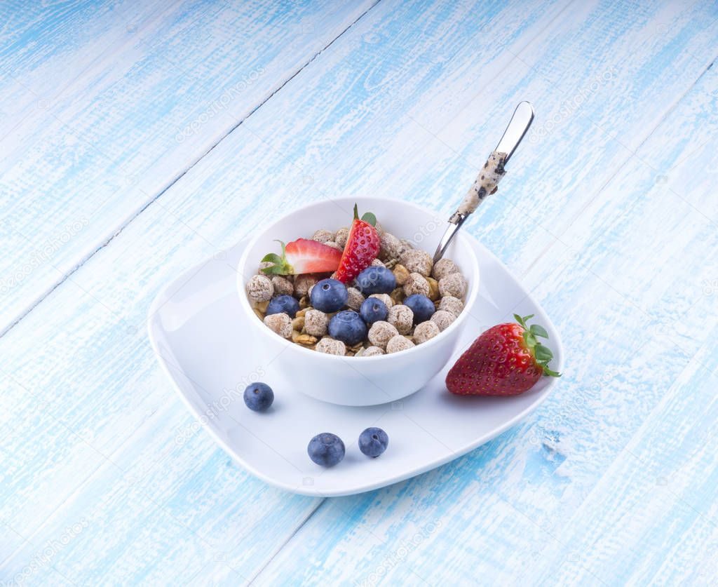 Food made of granola and musl a blue wooden table top view