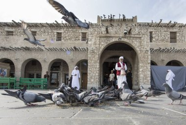 Pigeons in front of Souq Waqif