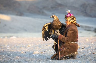 Eagle hunter with his Altai Golden Eagle