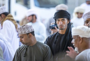 men at a market in Nizwa