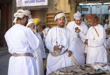 omani man buying a sword