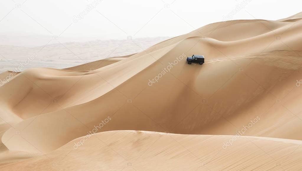 car driving in Rub al Khali Desert