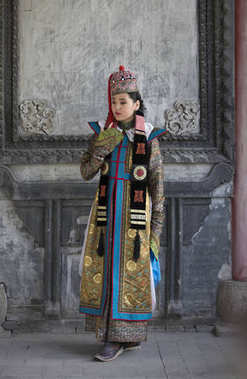 Mongolian woman in traditional outfit