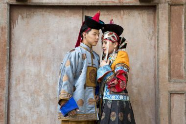 mongolian couple in traditional outfit