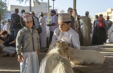 Nizwa, Oman, February 2, 2018: omani boys at a traditional goat auction