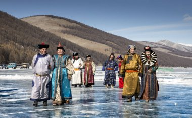 Hatgal, Mongolia, 4th March 2018: mongolian people dressed in traditional clothing on a frozen lake Khuvsgul