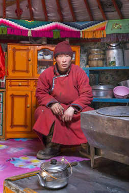 Hatgal, Mongolia, 2nd March 2018: mongolian man in the kitchen of his family ger (yurt)
