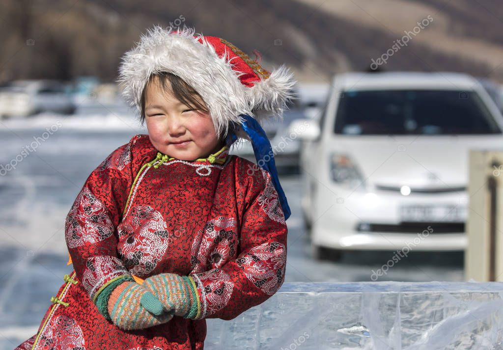 Hatgal, Mongolia, 4th March 2018: mongolian girl dressed in traditional clothing on a frozen lake Khuvsgul