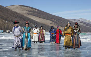 mongolian people dressed in traditional clothing