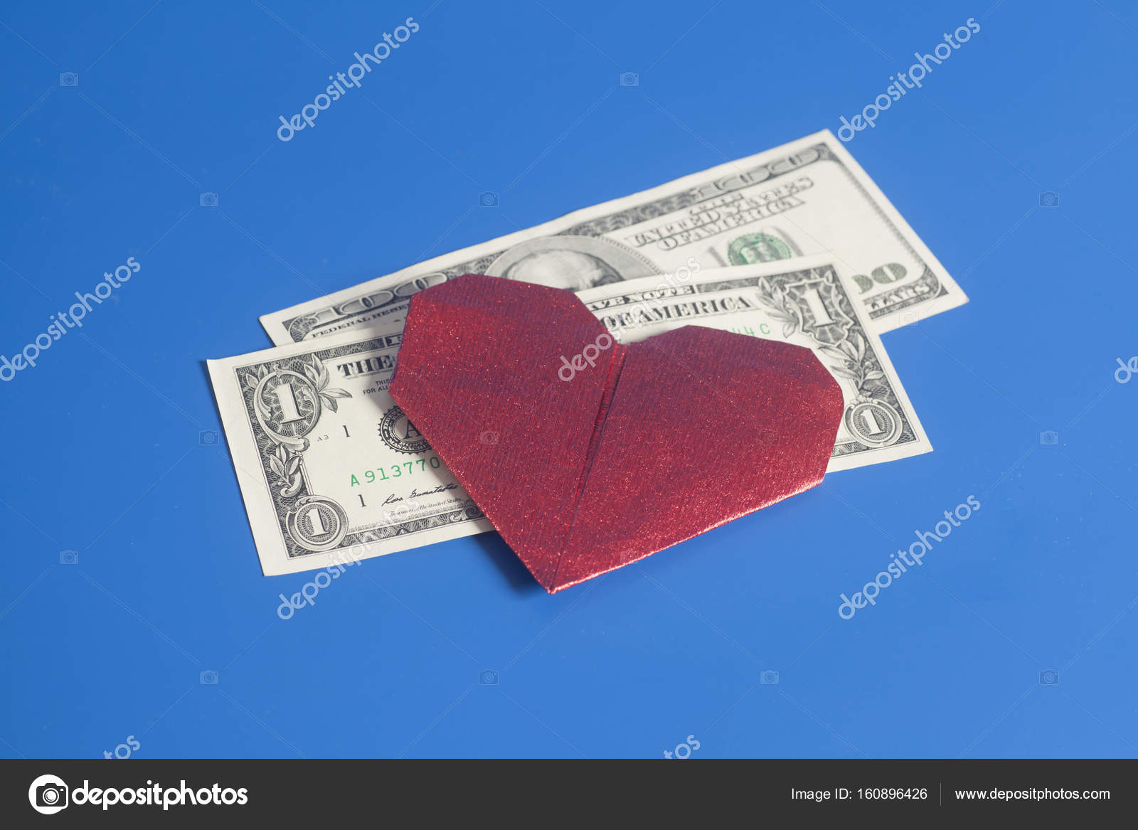 Red paper heart origami and dollar bills on blue background red paper heart origami and dollar bills on blue background stock photo jeuxipadfo Images