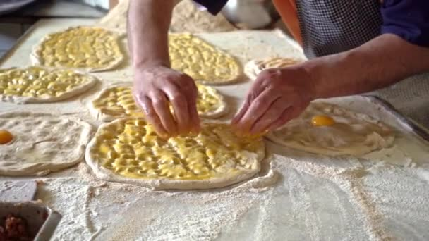 Turkish bakery masters gives shape to famous ramadan bread with his finger tips