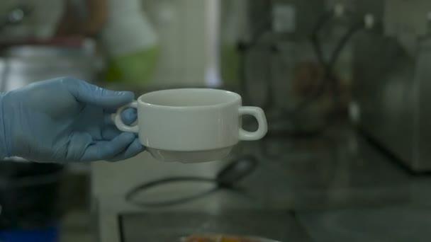 ladle soup into a bowl pour slow motion video