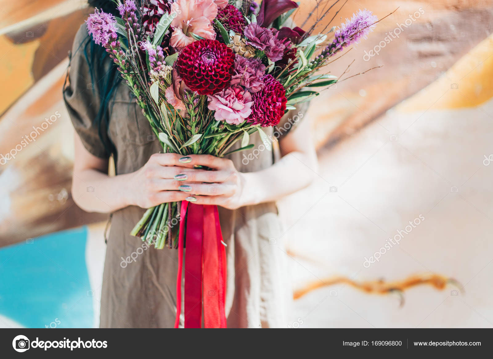 Woman hand holding bouquet of fresh flowers on light stock photo woman hand holding bouquet of fresh flowers on light stock photo izmirmasajfo