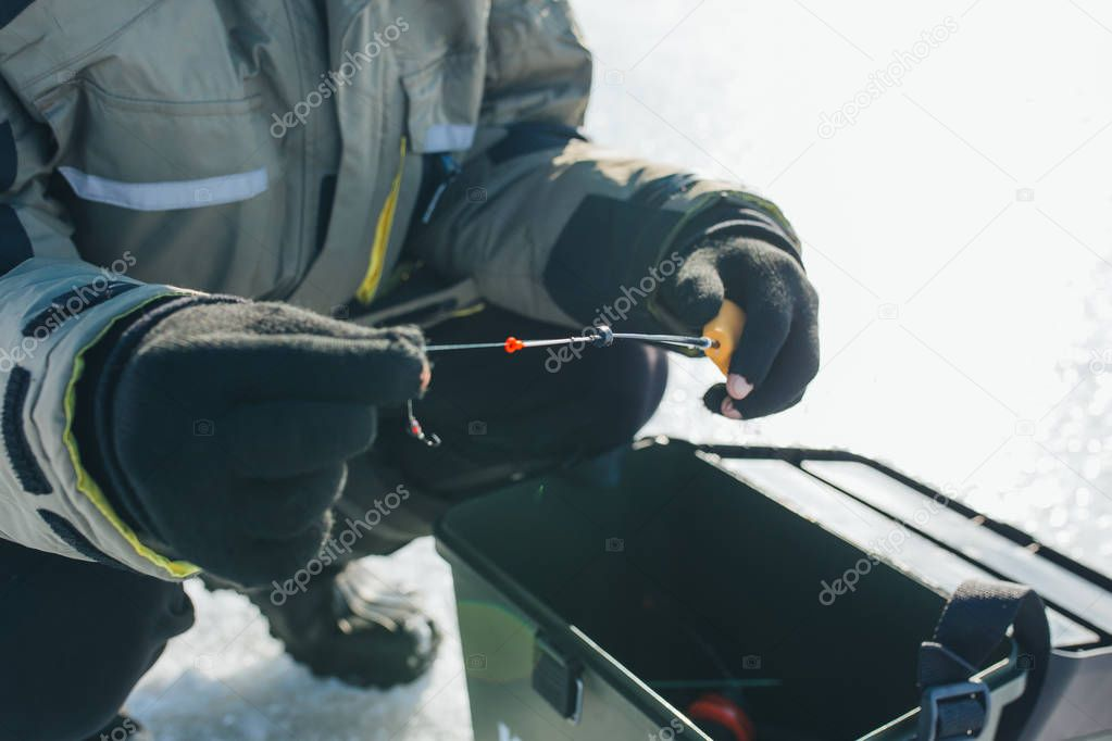 close up ice fishing tackles and equipment. winter holidays and people concept