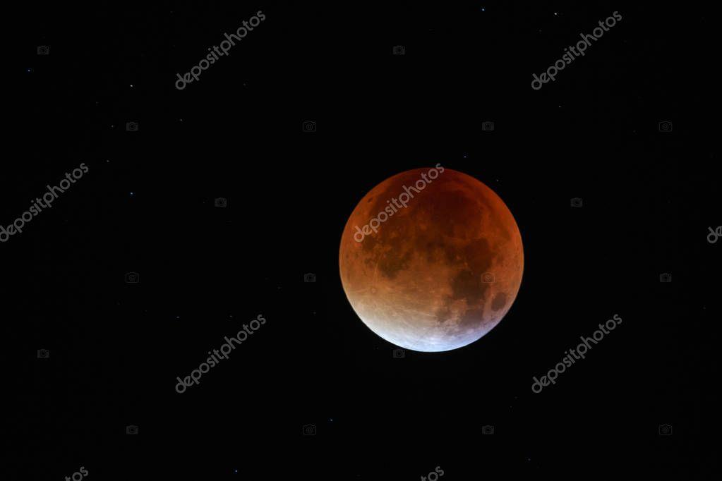 Bloody moon on dark sky