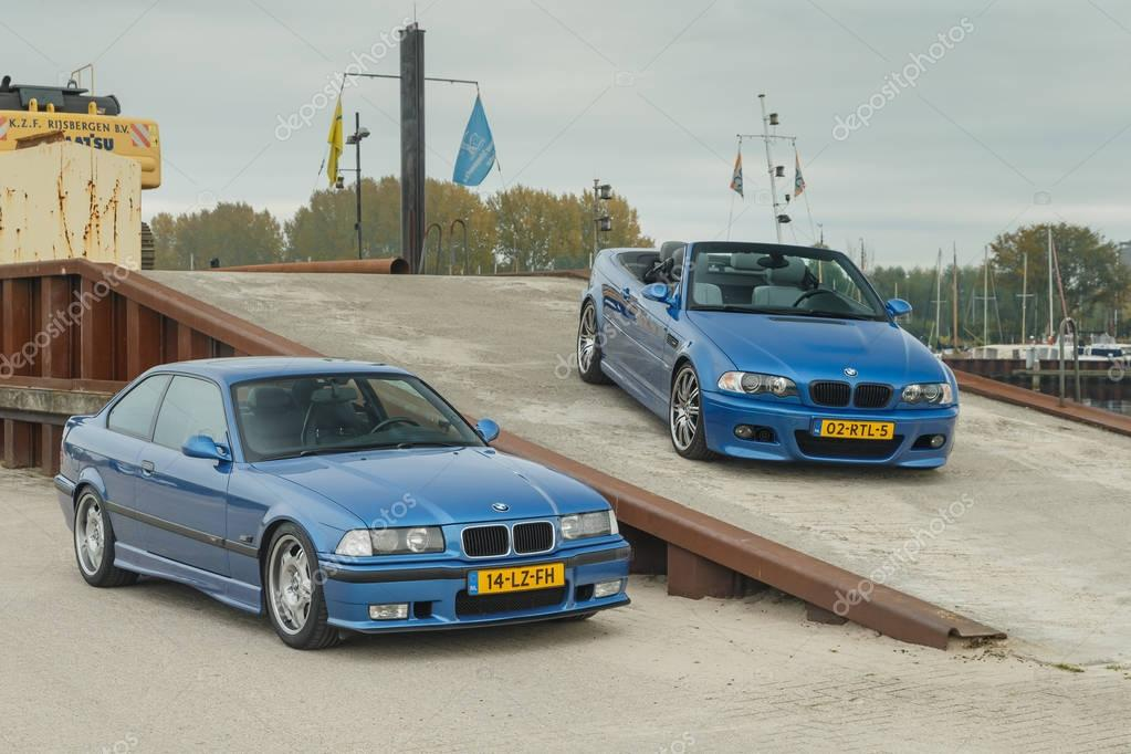 BMW M cars at a small harbor