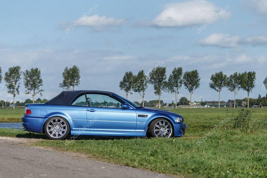 BMW M3 e46 convertible standing in a polder.