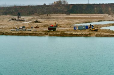 gidronamyv sand and extraction of sand and gravel, mining of sand, development sand pits, scrapers and bulldozers, a dredger