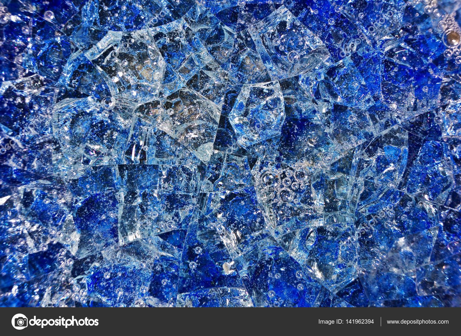 Vetro rotto blu con le bolle daria. sfondo fantasia composto di