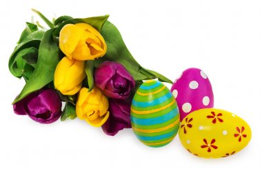 Composition of Easter eggs, flowers, tulips. Easter eggs in mult