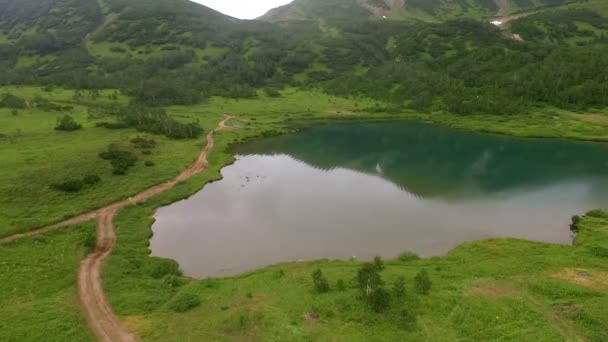 Reflection of mountains in water. Wildlife Russian air. Rotate the camera in the air