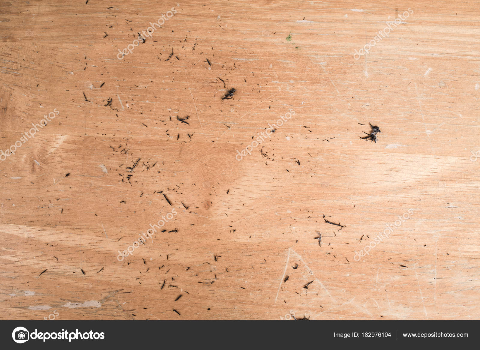 piece of eraser on wooden background close up stock photo