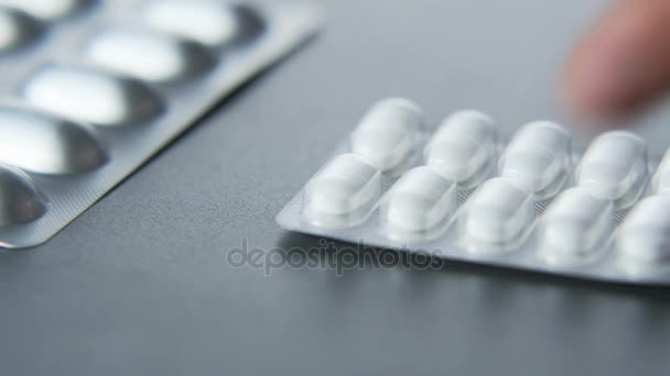 Man Putting White Tablets on Table