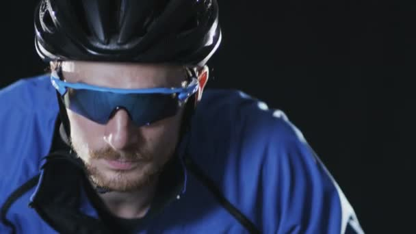 Man Wearing Helmet and Glasses Riding a Bicycle