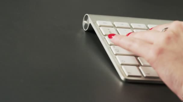Woman Typing on a Keyboard and Using Mouse. Extreme close-up. Shot on RED Epic
