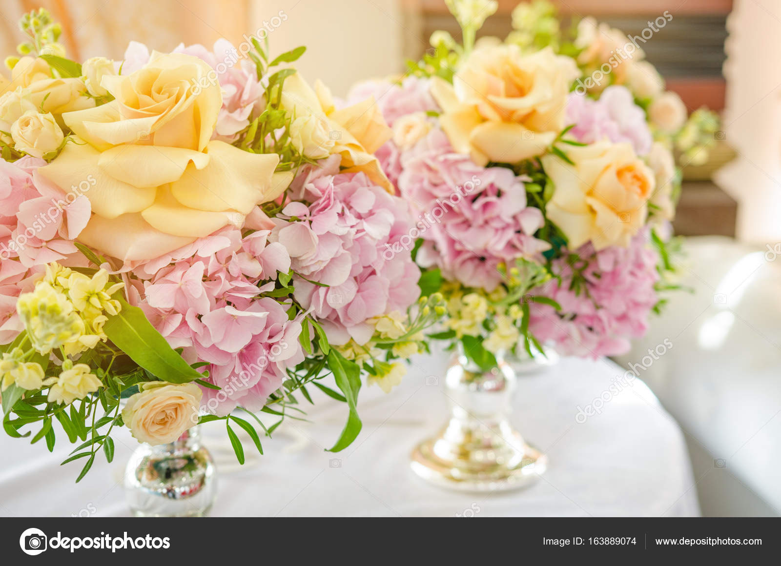 Big Bouquet Of Pink Hydrangeas And Yellow Roses Stands On Dinner