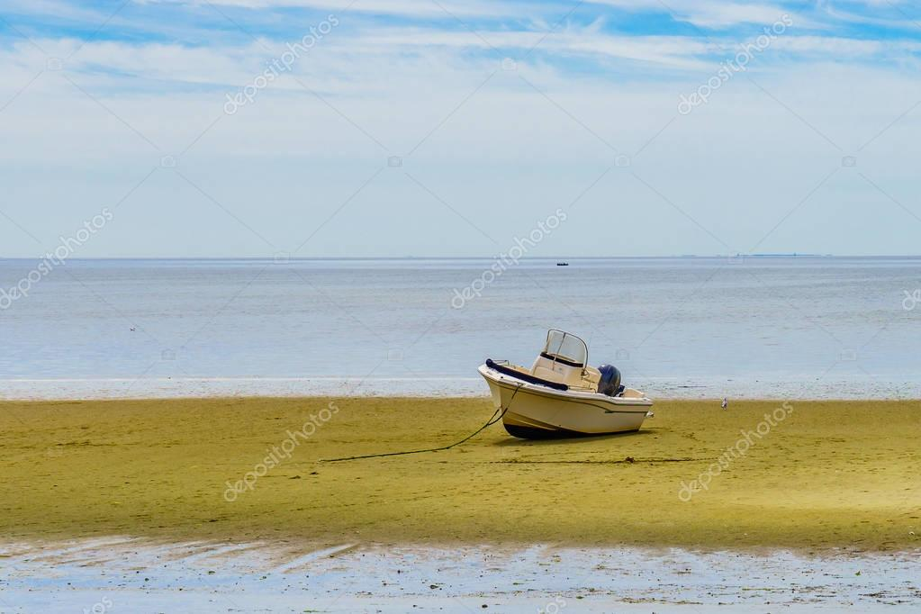 Boats in the Provincetown Coast at low tide MA