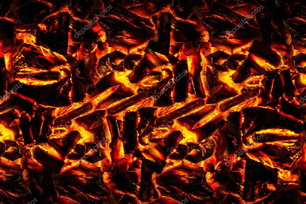 Smoldering ashes of a bonfire. incandescent orange and red embers texture. Concept from alfaphoto