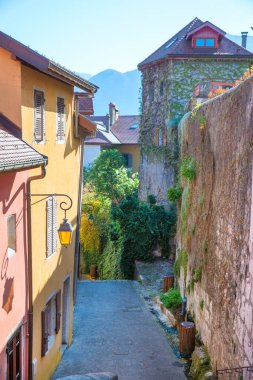 Little old narrow street in France. Bright colors and sunny day.