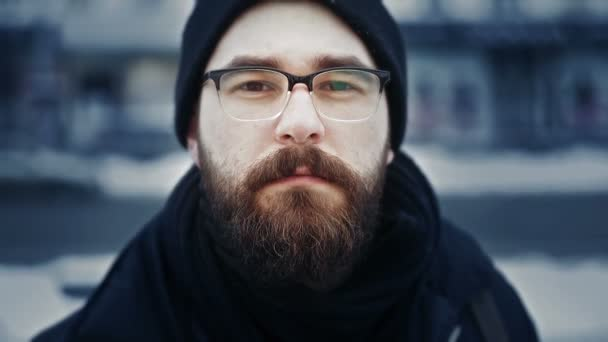 Portrait of caucasian man in hat cap and glasses on winter street