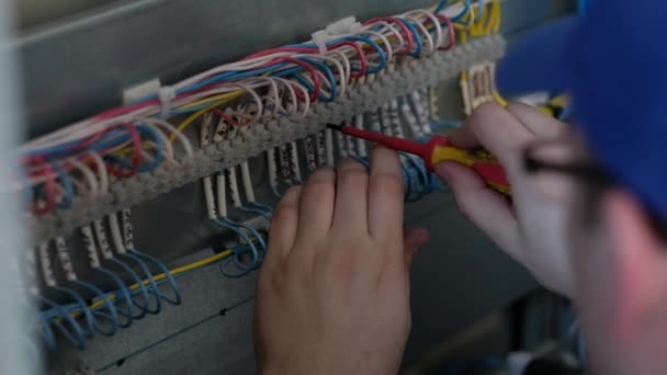 Closeup: Electrician at Work, Electrician Checks the Wiring Connection, on