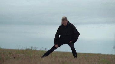 slowmotions sport female walking in a field
