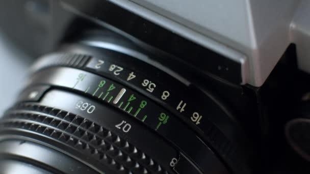 Close-up vintage photo camera details, setting up the film camera.