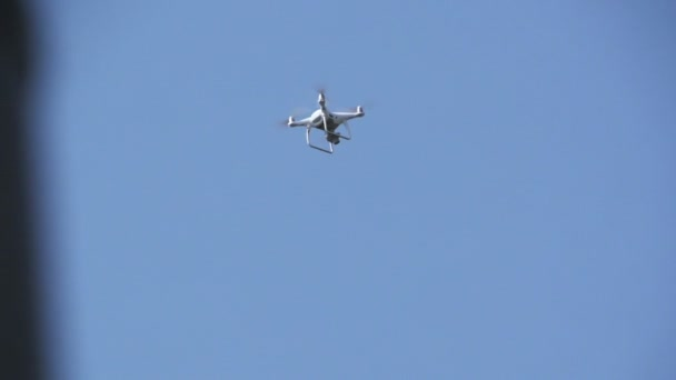 White drone, quadrocopter with photo camera flying concept