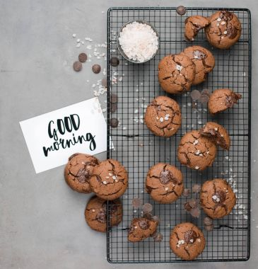 Chocolate chip cookies with dark chocolate and sea pink Himalayan salt on a gray concrete background. Best Brown Butter Cookies. Good morning!Flat lay, top view