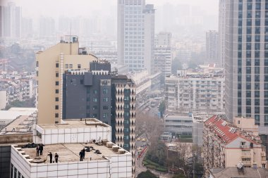 close up of buildings in smog