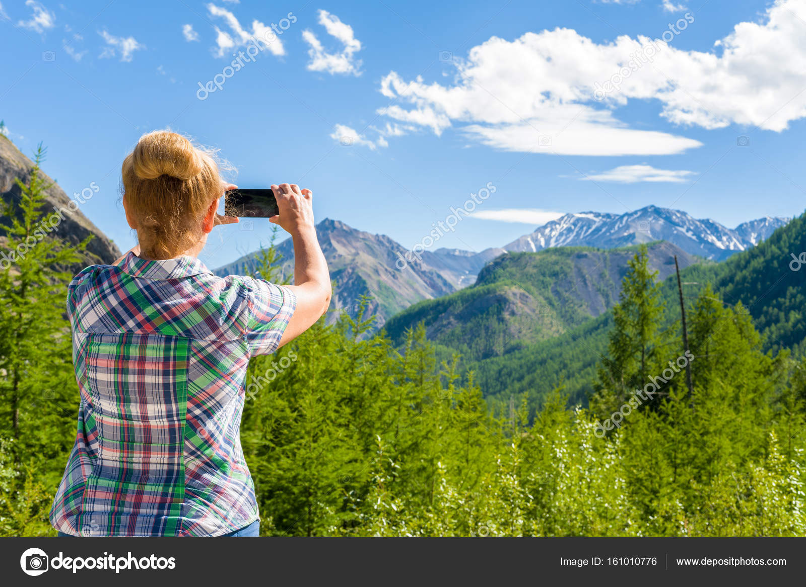 woman photographing landscape eastern sayan siberia russia