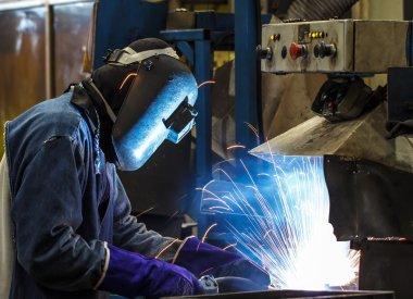 worker welding auto parts
