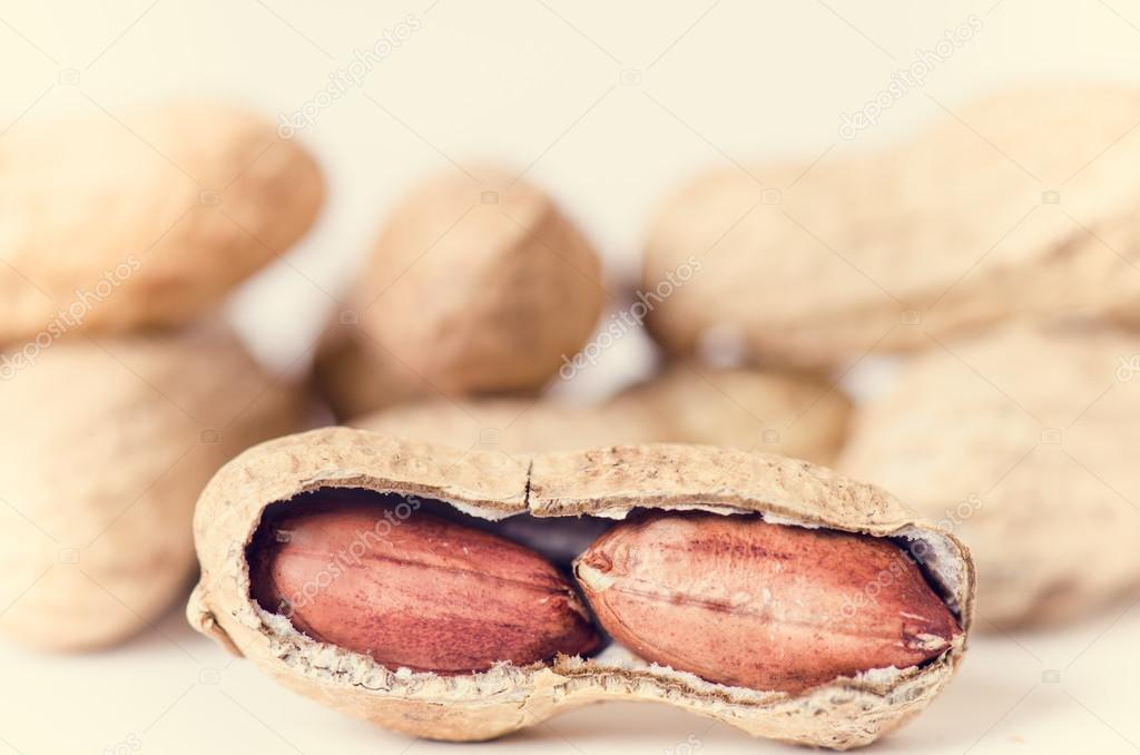 Peanuts on a white background. Isolated. Building from nuts ...