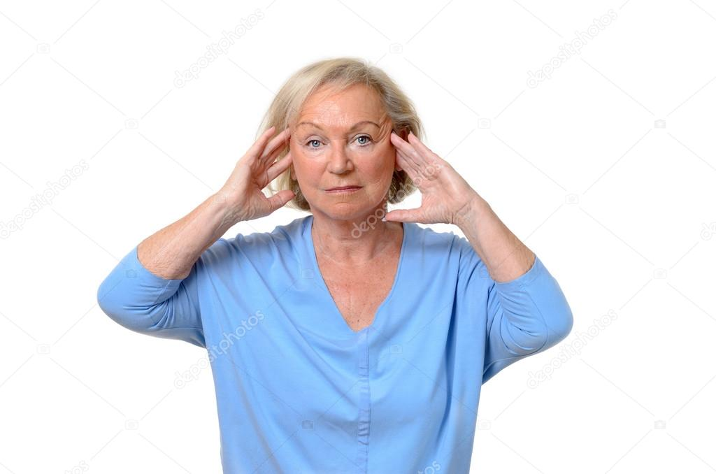 Attractive elderly lady suffering from a headache
