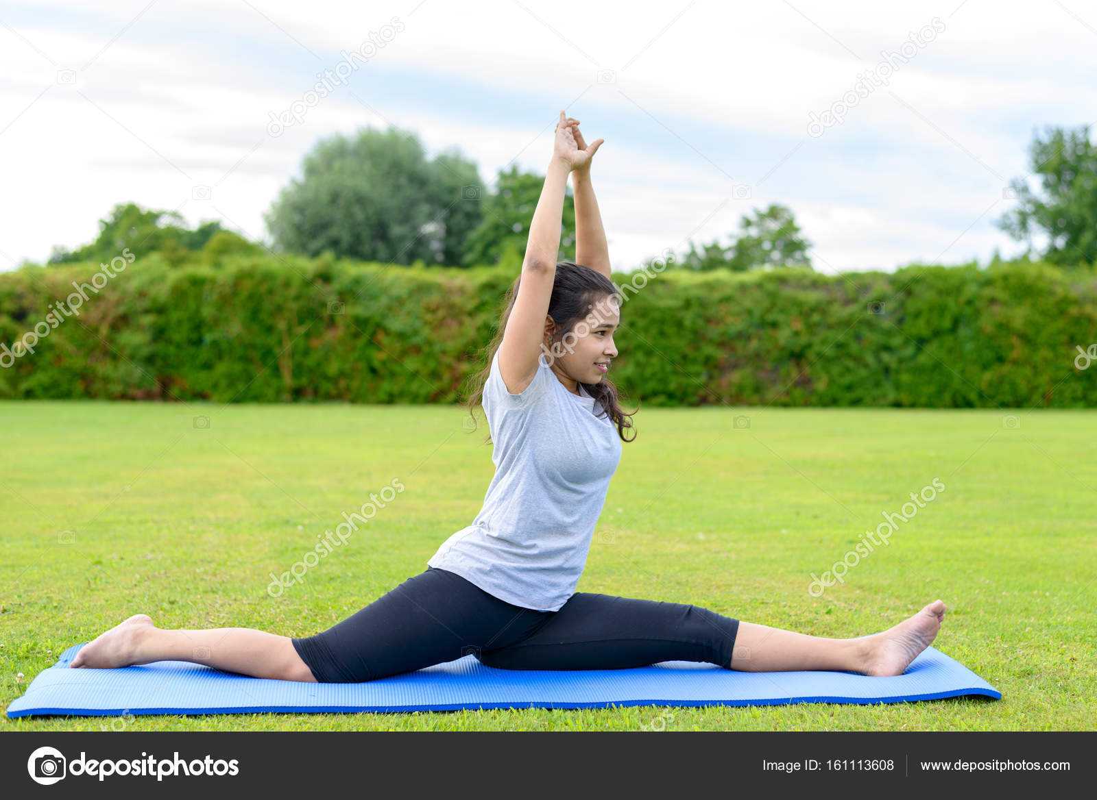 Portrait Of Teenage Girl Practising Yoga On Mat Outdoors Side Full Split Photo By Infomichaelheim Photographer