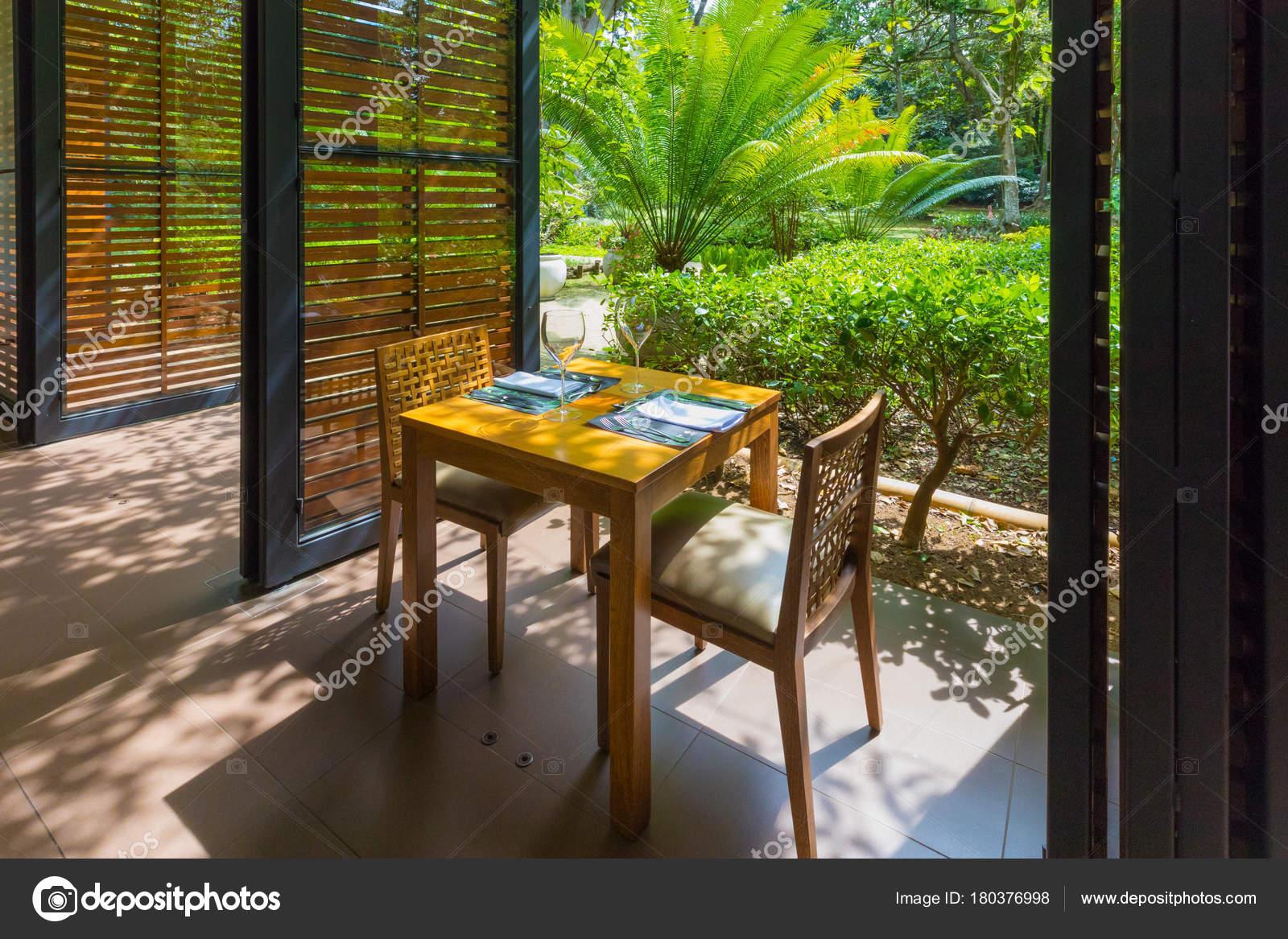 Restaurant Table Set Overlooking Tropical Garden Stock Photo C Markpittimages Gmail Com 180376998