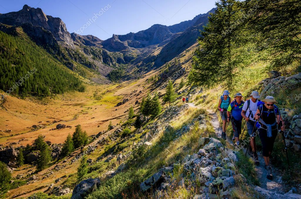 Hikers on a path in Mercantour National Park (France)