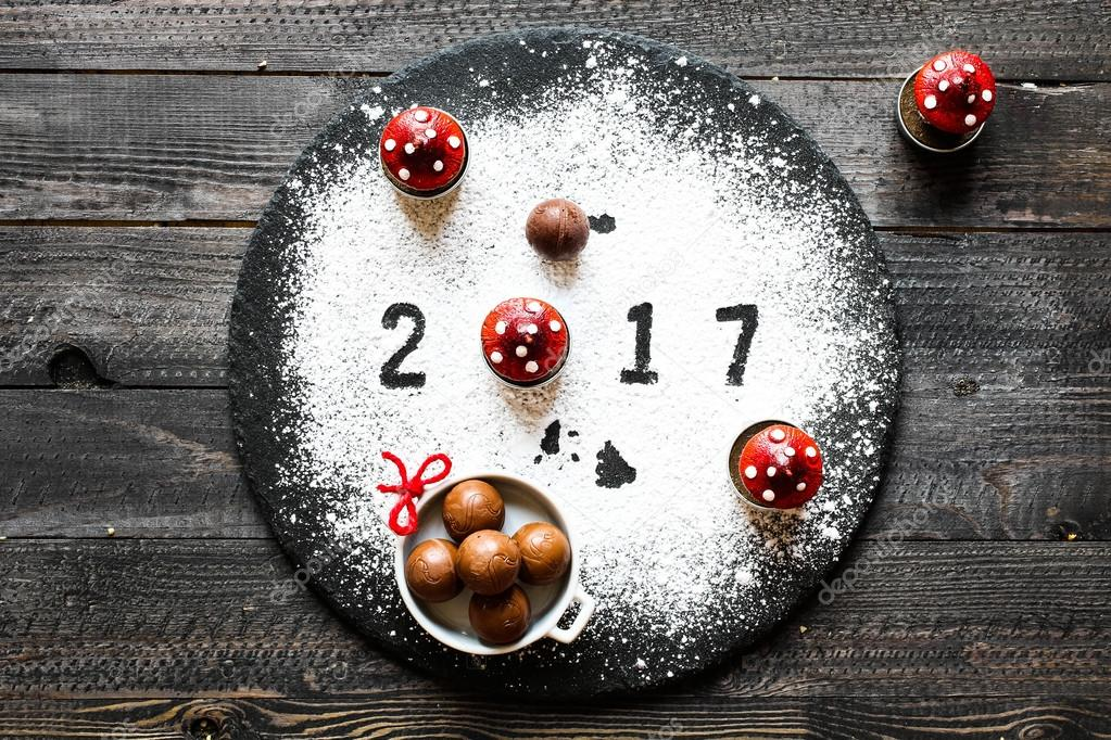 2017 Happy new year table with sugar and chocolate