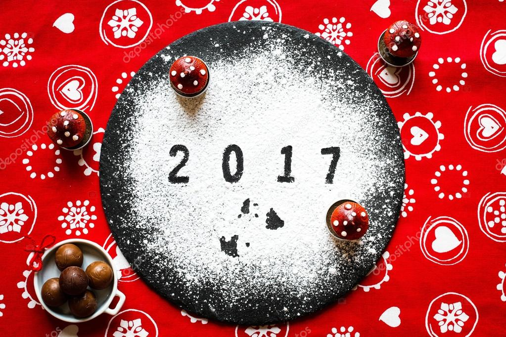 2017 happy new year table with sugar and chocolate and christmas decorations photo by besaselimishthotmailcom