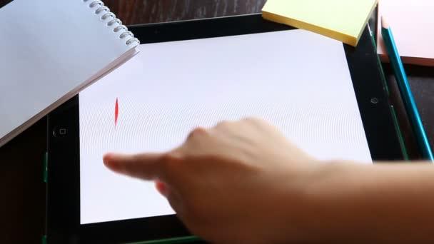 Love. Written on white background on tablet.